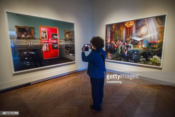 A woman looks a images on display during a press preview for 'David LaChapelle Lost Found' at the Fondazione Tre Oci on April 11 2017 in Venice Italy...