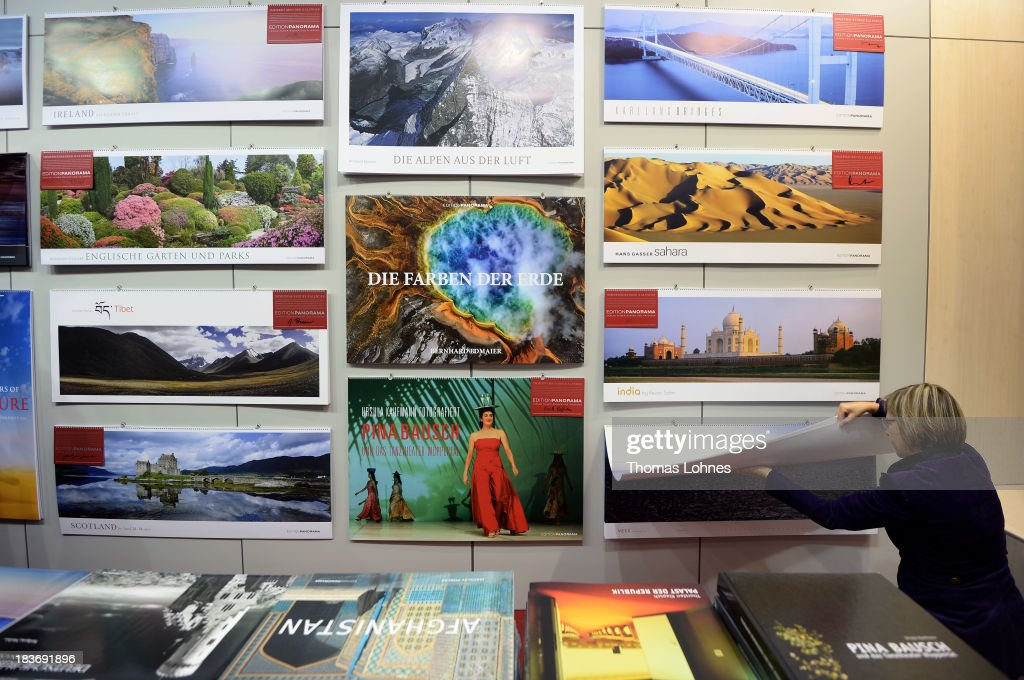 A woman looks a panorama calendar at the 2013 Frankfurt Book Fair on October 9, 2013 in Frankfurt, Germany. This year's fair will be open to the public from October 9-13 and the official partner nation is Brazil.