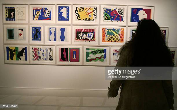A woman looks at a 1947 painting by Henri Matisse 'Jazz' as part of the exhibition at the musee du Luxembourg on March 15 2005 in Paris France The...