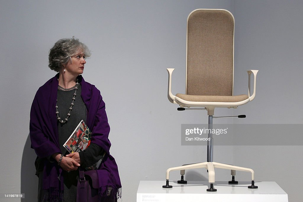 A woman looks at a 60's chair on display at the Victoria and Albert museums' new major exhibition, 'British Design 1948-2012: Innovation In The Modern Age' on March 28, 2012 in London, England. The exhibition showcases some of the most iconic product design, fashion, furniture, graphics, architecture and fine art from the last 60 years, and opens to the public from March 31, 2012.
