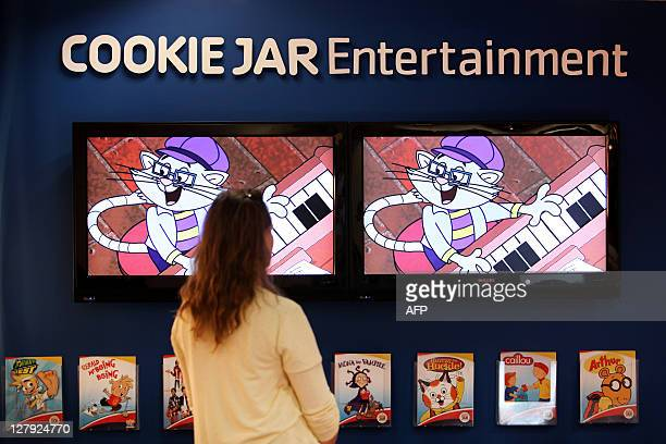 A woman looks at a cartoon on a TV screen on October 3 2011 in Cannes southern France during the international MIPCOM audiovisual trade show AFP...