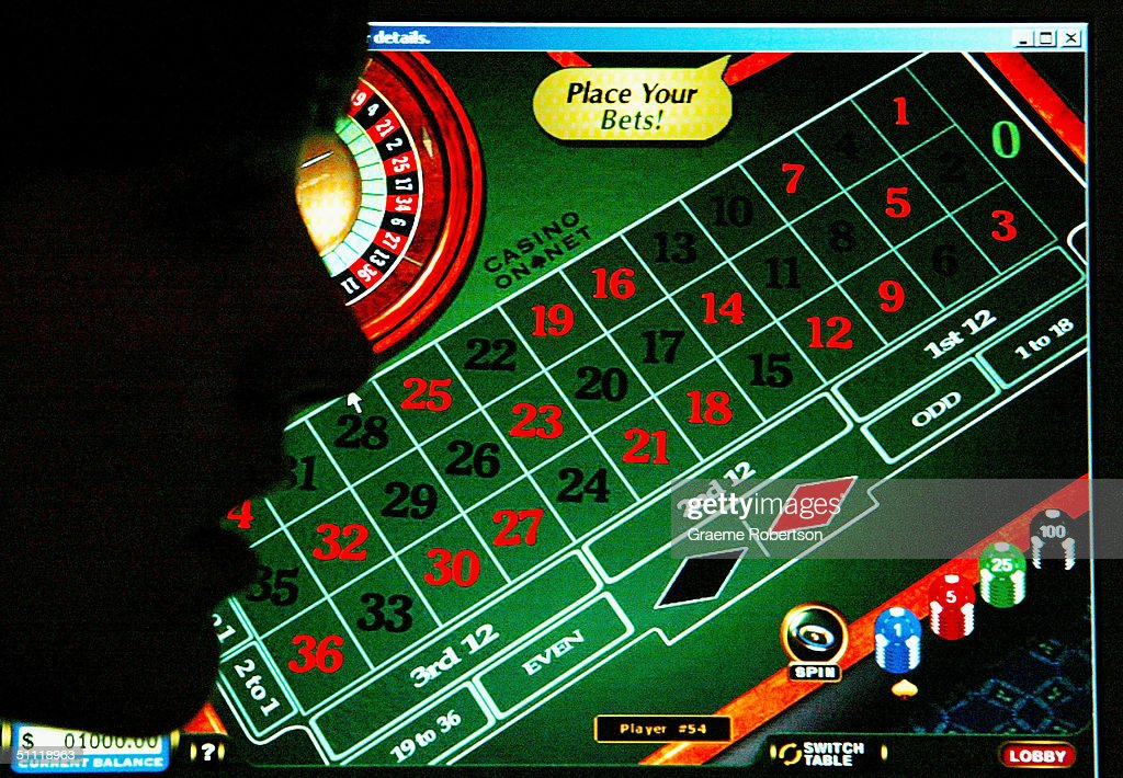 A woman looks at a casino website on July 27 2004 in London Internet gambling websites should introduce ageverification checks to prevent children...