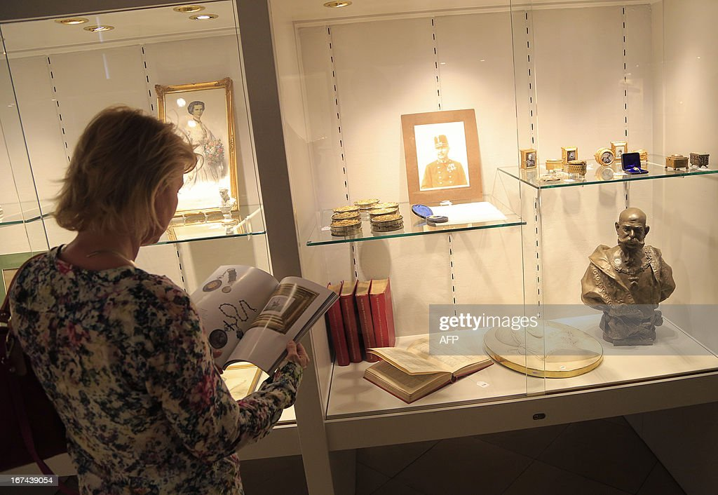A woman looks at a catalog next to a lock of hair from Emperor Franz Joseph I of Austria prior to an auction of Imperial Court Memorabilia and Historical Objects at the Palais Dorotheum in Vienna on April 25, 2013. The lock of hair was sold for 11,000Euros.