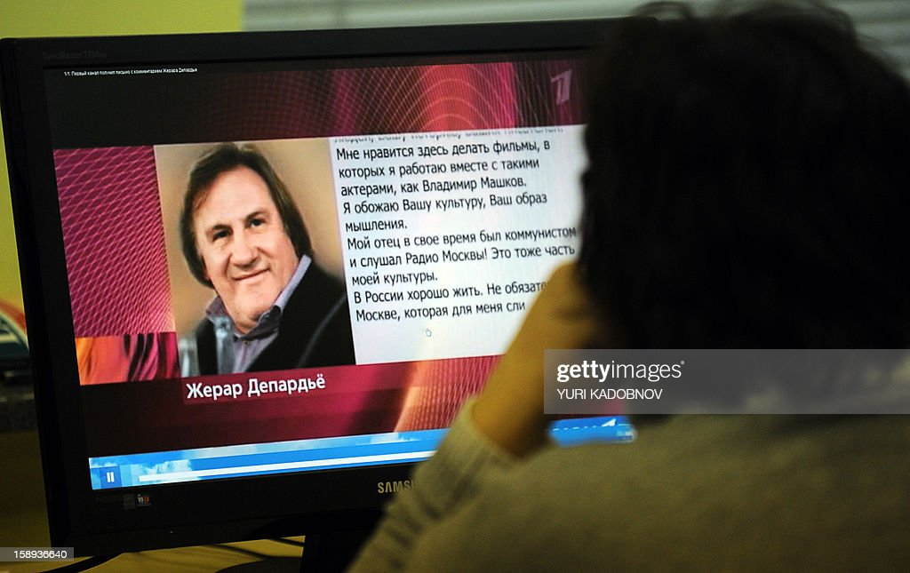 A woman looks at a computer screen displaying a webpage of Russian TV station Pervyi Kanal internet site in Moscow on January 4, 2013 that shows a picture of French actor Gerard Depardieu and a letter by the actor translated into Russian. Depardieu confirmed yesterday that he had applied for a Russian passport and said he was 'pleased' to have been granted citizenship by President Vladimir Putin. Yes, I filed a passport application and I am pleased that it was accepted. I love your country, Russia -- its people, its history, its writers,' he said in an open letter broadcast on Russian TV station Pervyi Kanal, following a highly publicised row with French authorities over their proposal to increase the tax rate for millionaires to 75 percent. AFP PHOTO / YURI KADOBNOV