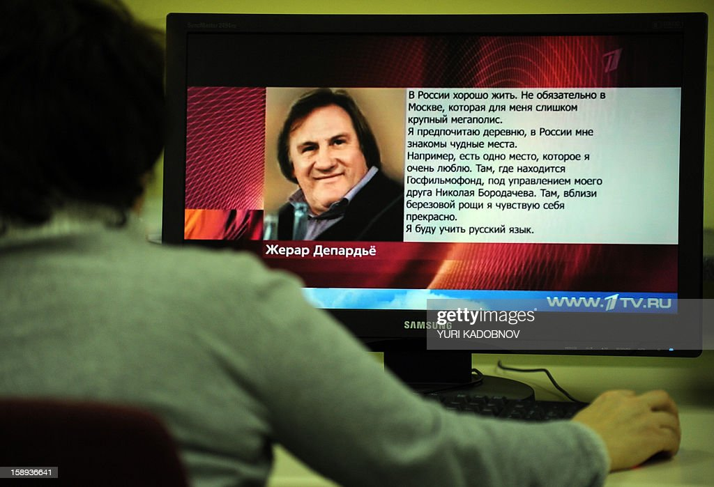 A woman looks at a computer screen displaying a webpage of Russian TV station Pervyi Kanal internet site in Moscow on January 4, 2013 that shows a picture of French actor Gerard Depardieu and a letter by the actor translated into Russian. Depardieu confirmed yesterday that he had applied for a Russian passport and said he was 'pleased' to have been granted citizenship by President Vladimir Putin. Yes, I filed a passport application and I am pleased that it was accepted. I love your country, Russia -- its people, its history, its writers,' he said in an open letter broadcast on Russian TV station Pervyi Kanal, following a highly publicised row with French authorities over their proposal to increase the tax rate for millionaires to 75 percent.