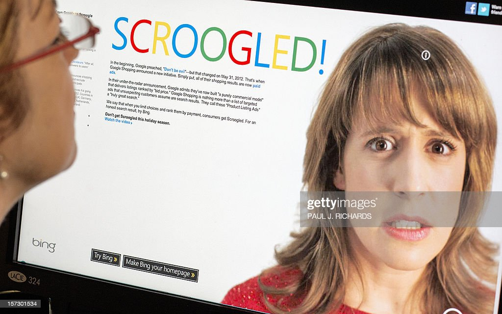 A woman looks at a computer site on November 30, 2012 in Washington, DC. - Just in time for the holidays, Microsoft and Google have become embroiled in a bitter dispute over who is the fairest of them all for online shopping, stepping up the battle between the tech giants.Microsoft threw the first punch when it launched a campaign for its Bing search engine 'to highlight Bing's commitment to honest search results.' The campaign also seeks 'to help explain to consumers the risks of Google Shopping's newly announced 'pay-to-rank' practice,' a Microsoft statement said. As part of the campaign, Microsoft created a Web page called 'Scroogled,' which points out that its rival has reversed course on its pledge at the time of the Google stock offering to avoid paid ad inclusion for search results. AFP Photo/Paul J. Richards