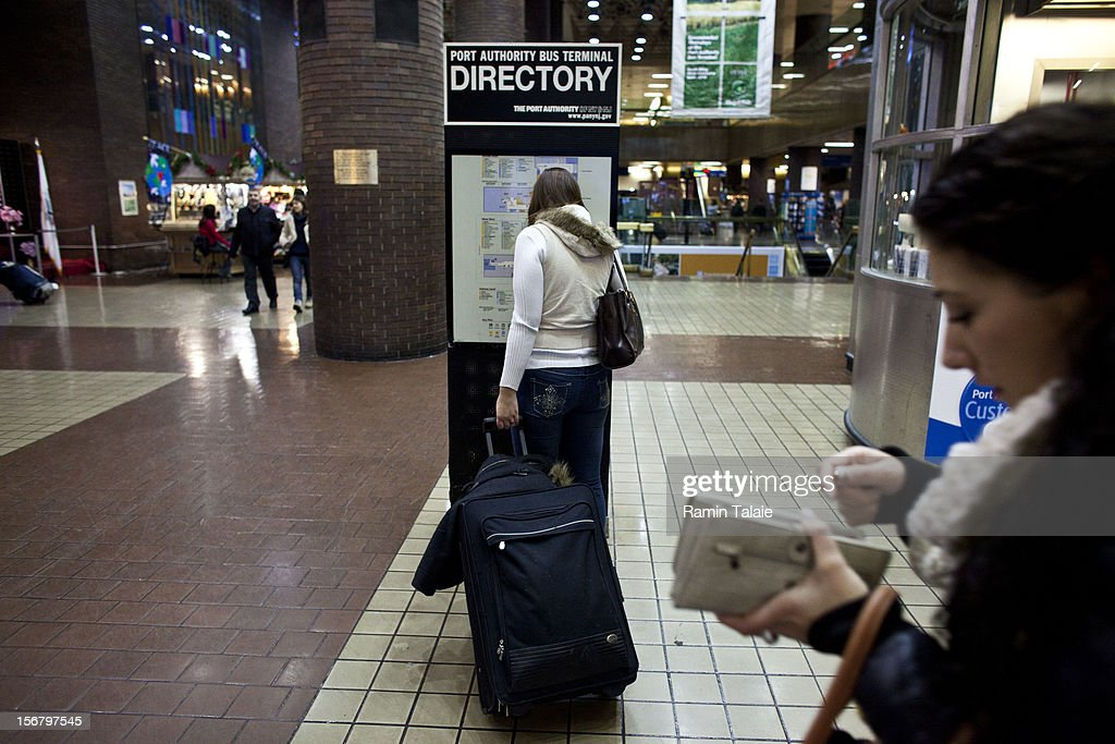 A woman looks at a directory at the New York Port Authority bus terminal in Manhattan on November 21, 2012 in New York City. The Port Authority of New York and New Jersey is expecting to handle a high number of travelers at its hubs, bridges, and tunnels ahead of the Thanksgiving holiday.