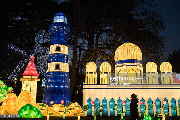A woman looks at a giant illuminated lantern display during the preview of the Magical Lantern Festival at Chiswick House and Gardens on January 17...