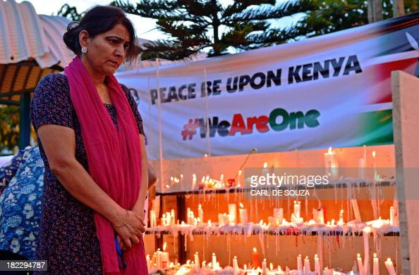 A woman looks at a list of victims outside the Westgate Mall on September 29 2013 in Nairobi Kenyan police arrested today another suspect over the...
