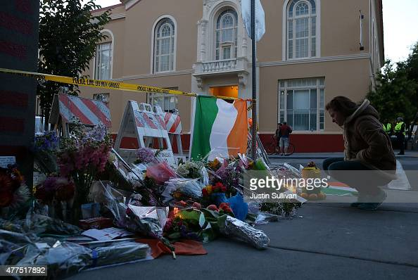A woman looks at a makeshift memorial outside of an apartment where six students died in an early Tuesday morning balcony collapse on June 17 2015 in...