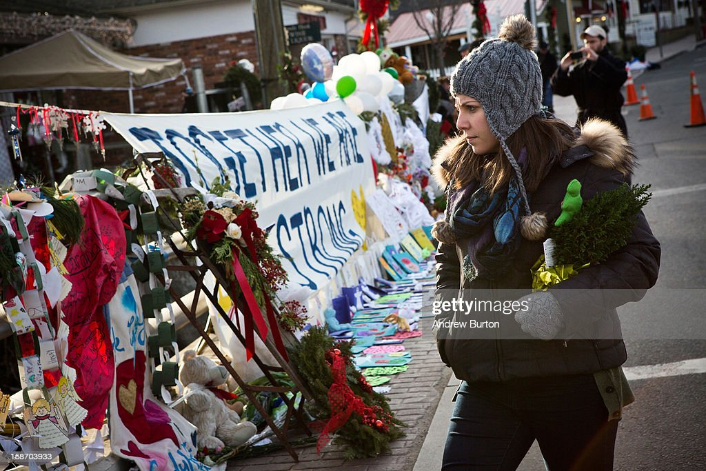 A woman looks at a memorial for those killed in the school shooting at Sandy Hook Elementary School, on December 24, 2012 in Newtown, Connecticut. Donations and letters are pouring in from across the country as the town tries to recover from the massacre.