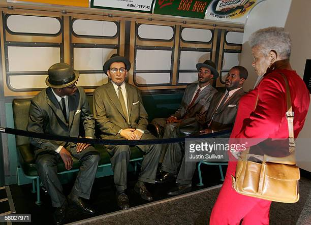 A woman looks at a model of the 'victory ride' at the Rosa Parks Museum October 28 2005 in Montgomery Alabama Rosa Parks who died Monday at the age...