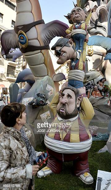 A woman looks at a 'ninot' representing President of proindependence Esquerra Republicana political party Oriol Junquera regional president of...