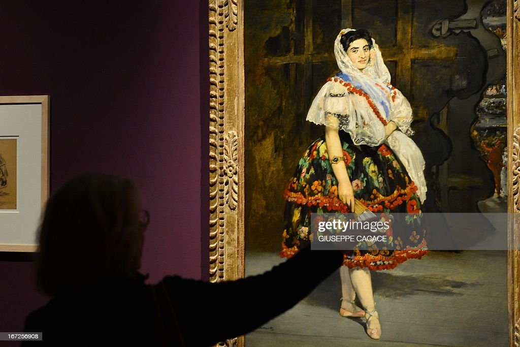 A woman looks at a painting by Edouard Manet on April 23,2013 in Venice, during the 'Manet Return to Venice' exhibition, which runs until 18 August 2013, at the Doge's Palace in Venice. Edouard Manet's 'Olympia' will be appearing alongside the Titan's 'Venus of Urbino' a masterpice of Renaissance and source of ispiration for the French artist. AFP PHOTO / GIUSEPPE CACACE