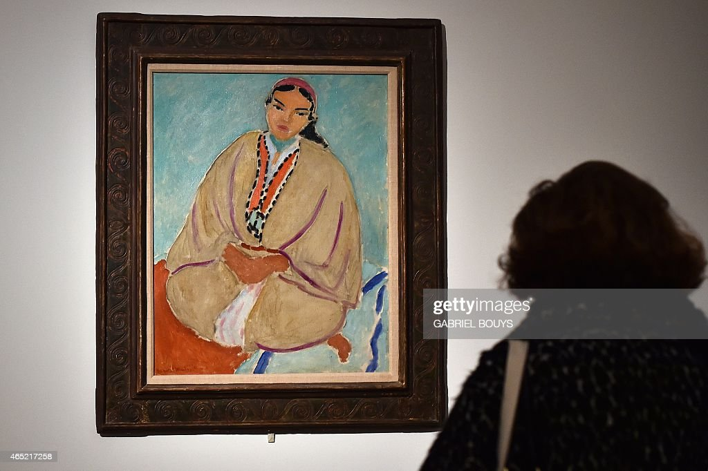 A woman looks at a painting by French artist <a gi-track='captionPersonalityLinkClicked' href=/galleries/search?phrase=Henri+Matisse&family=editorial&specificpeople=210882 ng-click='$event.stopPropagation()'>Henri Matisse</a> (Zorah in Yellow, 1912) during a press preview of the exhibition 'Matisse Arabesque' on March 4, 2015 at the Scuderie del Quirinale museum in Rome. The show will run from March 5 to June 21.