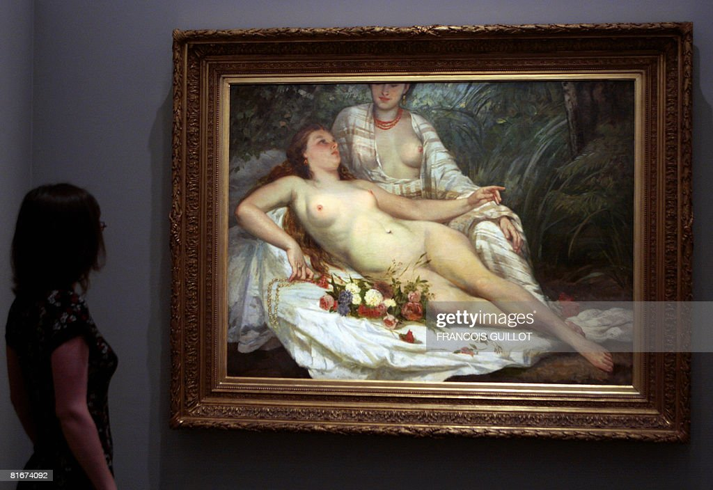 A woman looks at a painting by Gustave Courbet named 'Les baigneuses' displayed at Paris' Museum of the Art and History of Judaism on June 23 2008 in...