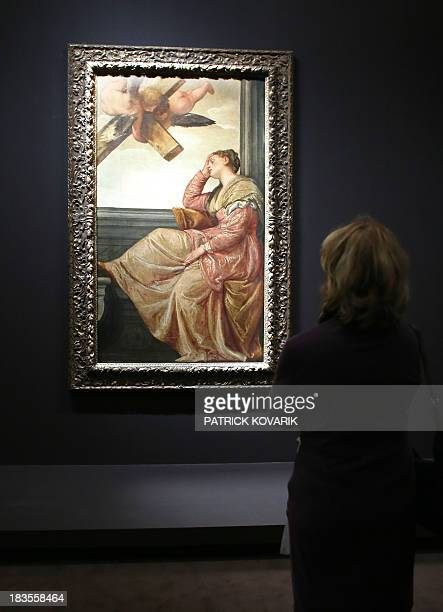 A woman looks at a painting by Italian artist Paolo Caliari also known as Veronese during the press presentation of the exhibition 'The Renaissance...