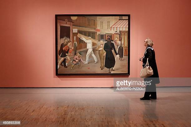 A woman looks at a painting by late French artist Balthus as she visits the exhibition dedicated to his work at the Villa Medici in Rome on October...