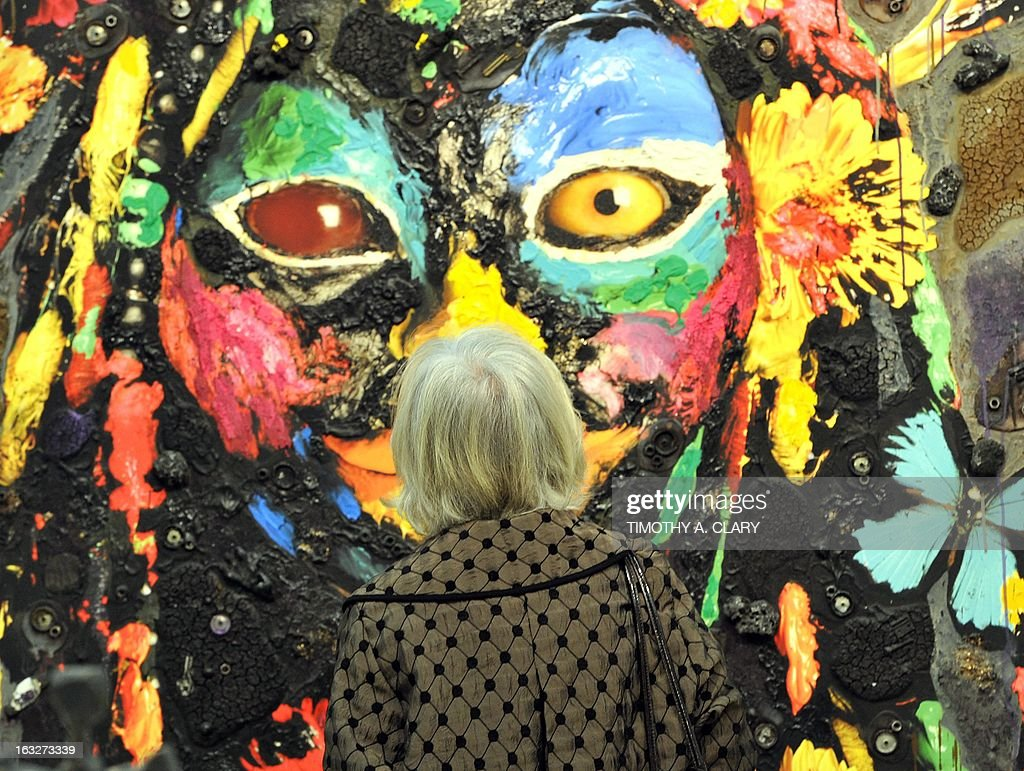 A woman looks at a painting during the press preview at the 2013 Armory Show, one of the world's top art events featuring the most influential artworks of the 20th and 21st centuries, at Pier 92 and 94 in New York March 6, 2013. The Armory Show Centennial Edition kicks off Armory Arts Week .