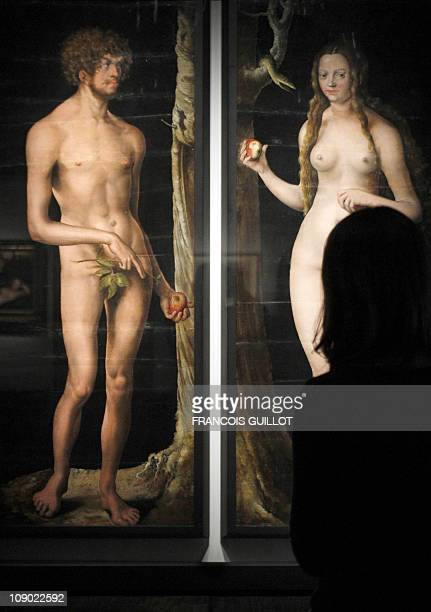 A woman looks at a painting entitled 'Adam and Eve' by German artist Lucas Cranach the Elder on February 07 2011 at the Musee du Luxembourg in Paris...