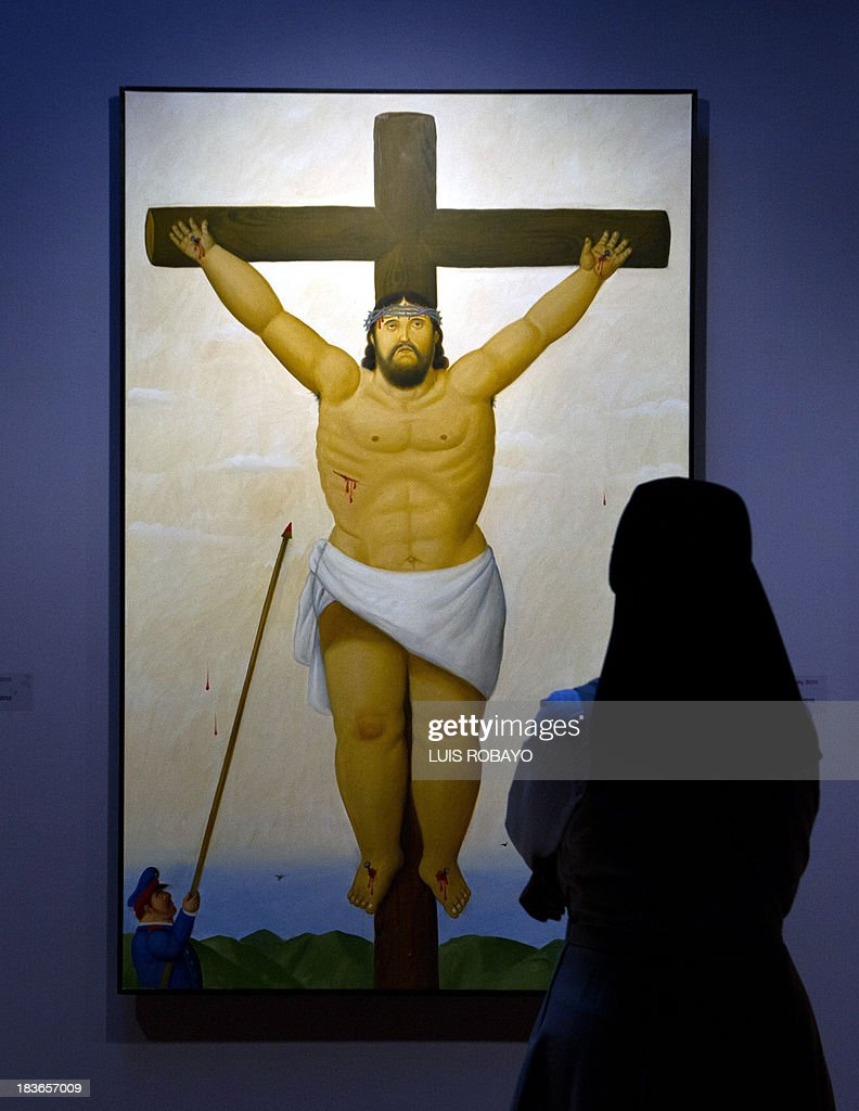 A woman looks at a painting named 'Crucifixion with soldier' of the exhibition 'Via Crucis, the passion of Christ' of Colombian artist Fernando Botero, on October 8, 2013, in Cali, department of Valle del Cauca, Colombia. Botero was the curator of his own exhibition, which is composed of 27 oil paintings and 34 drawings combining traditional aspects of Catholicism and the modern world. AFP PHOTO / LUIS ROBAYO