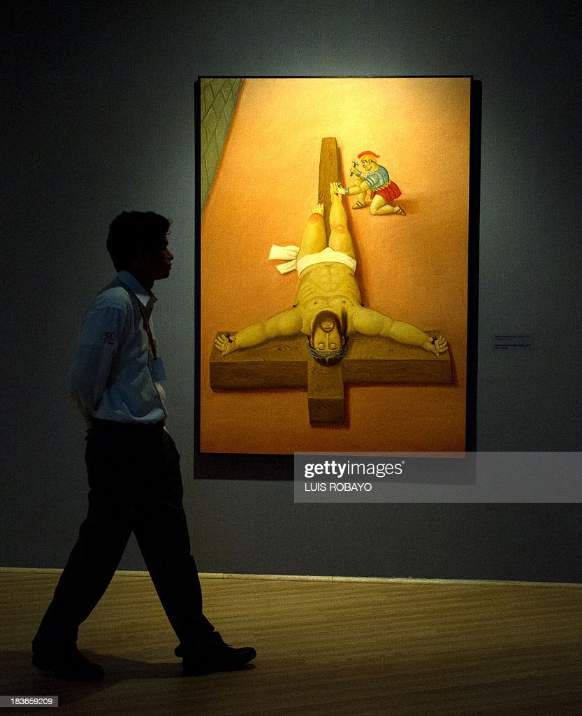 a woman looks at a painting named u0027jesus nailed to the cross u0027 of