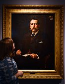 A woman looks at a painting of Sir Arthur Conan Doyle by Sidney Paget displayed at the Sherlock Holmes exhibition at the Museum of London in the...