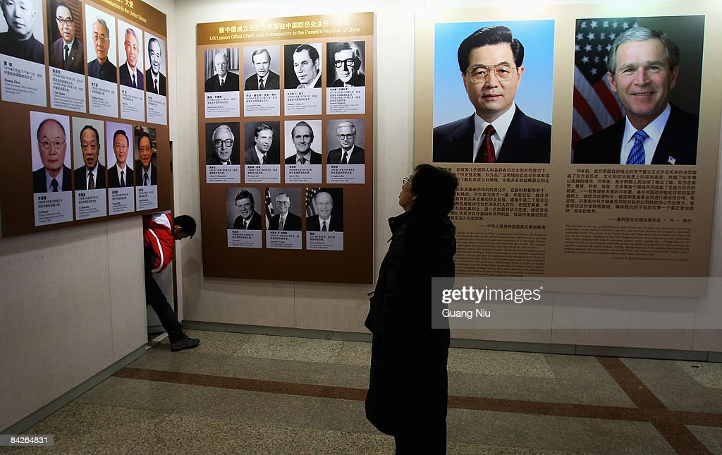 A woman looks at a photo exhibition celebrating 30 years of China-US diplomatic relations on January 13, 2009 in Beijing, China. The event is in commemoration of the thirtieth anniversary of the establishment of diplomatic ties between the United States and the People�s Republic of China which commenced on January 1st, 1979.