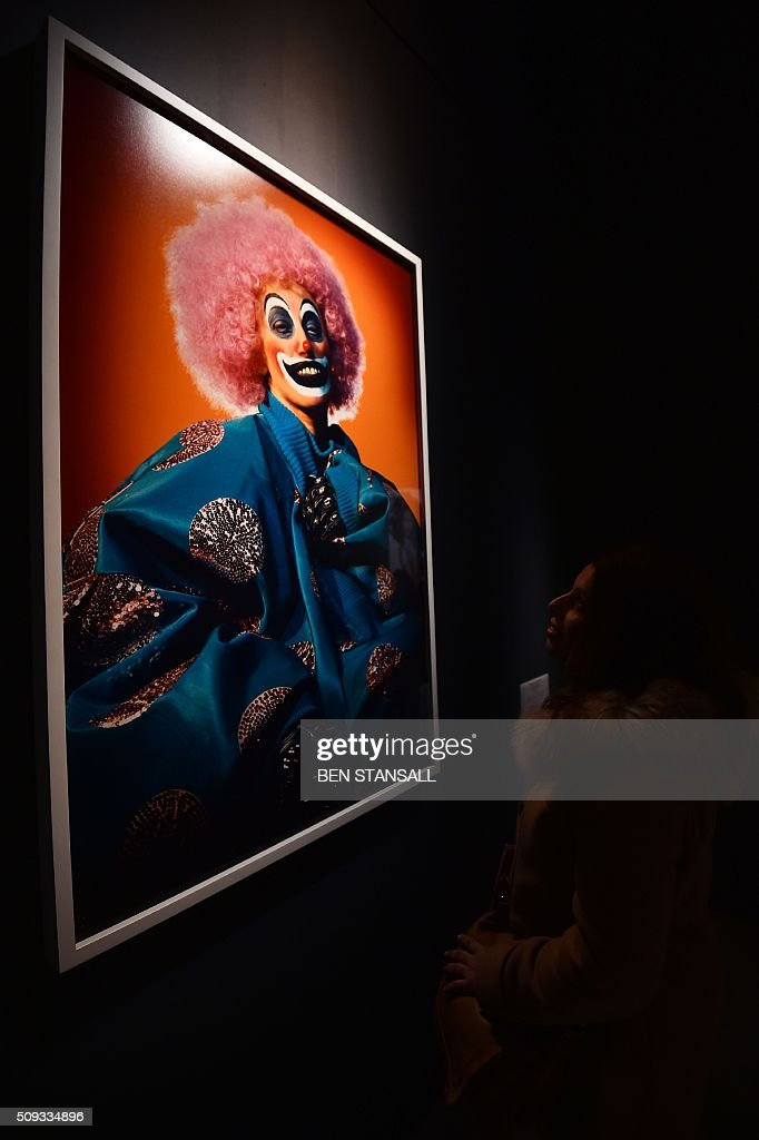 A woman looks at a photograph by Cindy Sherman entitled 'What Lies Beneath' 2003 as part of the 'Vogue 100 a Century of Style' exhibition at the National Portrait Galley in central London on February 10, 2016. The exhibition showcases a range of photography commissioned by British Vogue since it was founded in 1916. / AFP / BEN STANSALL / RESTRICTED TO EDITORIAL USE - MANDATORY MENTION OF THE ARTIST UPON PUBLICATION - TO ILLUSTRATE THE EVENT AS SPECIFIED IN THE CAPTION