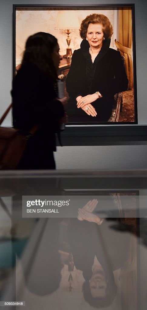 A woman looks at a photograph by David Bailey entitled 'Margaret Thatcher in 10 Downing Street' 1985 as part of the 'Vogue 100 a Century of Style' exhibition at the National Portrait Galley in central London on February 10, 2016. The exhibition showcases a range of photography commissioned by British Vogue since it was founded in 1916. / AFP / BEN STANSALL / RESTRICTED TO EDITORIAL USE - MANDATORY MENTION OF THE ARTIST UPON PUBLICATION - TO ILLUSTRATE THE EVENT AS SPECIFIED IN THE CAPTION