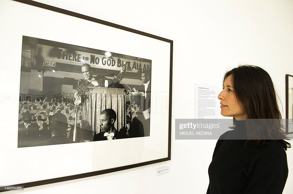 A woman looks at a photograph showing Malcolm X giving a speech at a black Muslim Rally in Washington D.C. taken in 1961 by late US photojournalist Eve Arnold on display during an exhibition entitled 'All About Eve' at the Arts Sensus Gallery in central London on March 1, 2012. Eve Arnold, a US photographer who took famous pictures of Marilyn Monroe among other renowned figures and was a pioneering member of the Magnum photo agency died on January 5 at the age of 99. Arnold was the first female photographer to become a full member of the storied Magnum agency in 1957. Her pictures of figures such as Monroe, Malcolm X and Marlene Dietrich were famous.