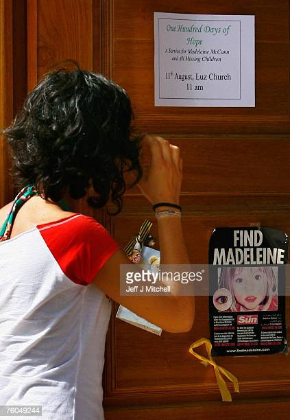 A woman looks at a poster and cards placed on the Church door in Praia da Luz for missing Madeleine McCann August 10 2007 in Praia da Luz Portugal...