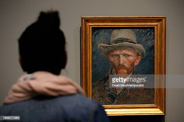 A woman looks at a self portrait of Vincent van Gogh four days after the Rijksmuseum Official Opening on April 17 2013 in Amsterdam Netherlands The...