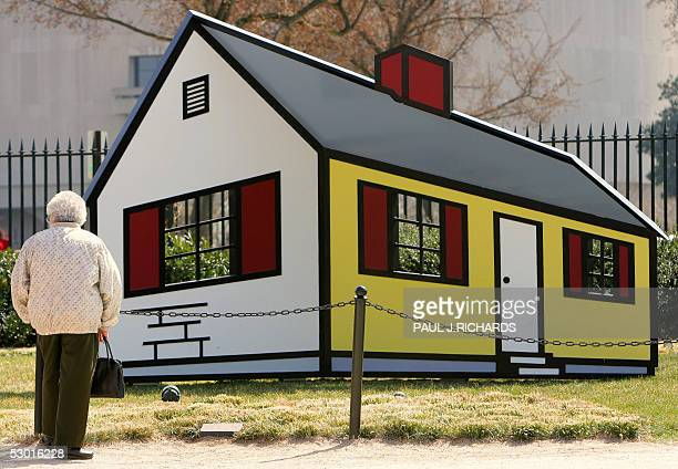 A woman looks at a work called 'House 1' at the National Gallery of Art Sculpture Garden 22 March 2005 by Roy Lichtenstein and made in 1996/1998 of...