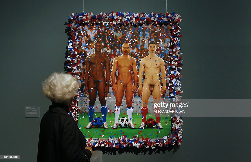 A woman looks at an artwork by French artist duo Pierre et Gilles (Pierre Commoy and Gilles Blanchard) entitled 'Vive la France (Long Live France)',as part of the 'Nackte Maenner' (Nude men) exhibition at the Leopold Museum in Vienna, on October 18, 2012. The exhibition takes opens its doors from October 19, 2012 to January 28, 2013.