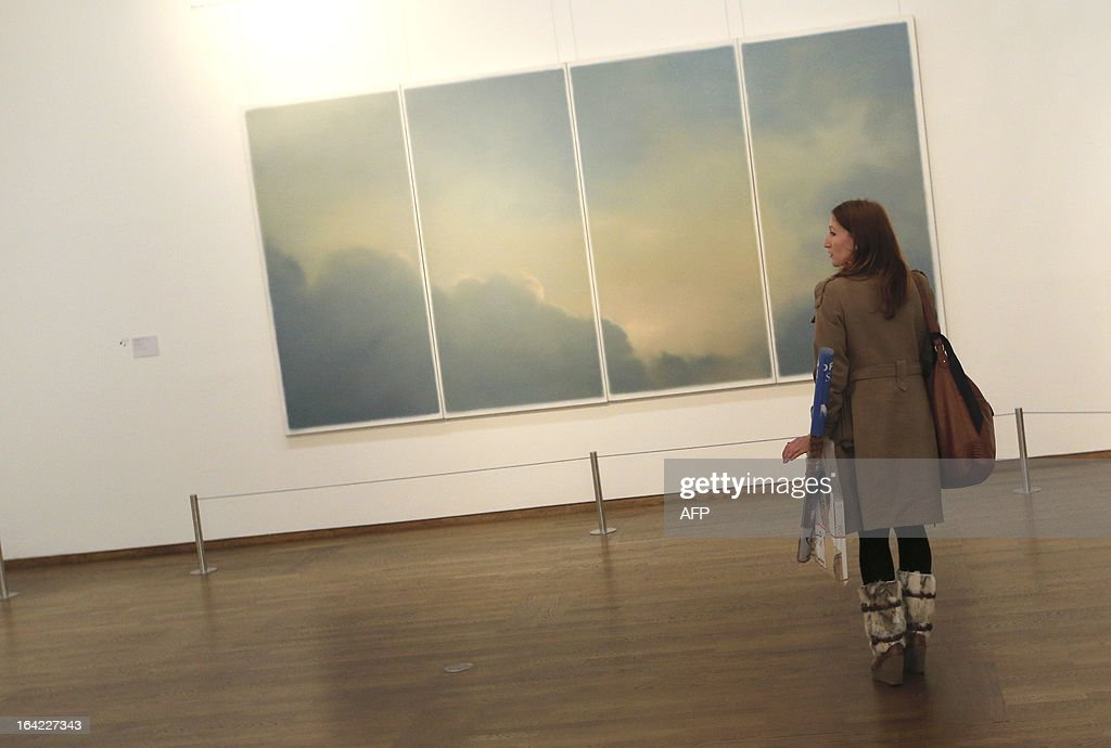 A woman looks at an artwork by German artist Gerhard Richter, titled 'Clouds (Window)' and dated 1970, as part of the 'Clouds' (Wolken) exhibition at the Leopold Museum in Vienna, on March 21, 2013. The exhibition will run until July 1, 2013.