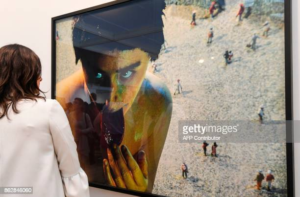 A woman looks at an artwork untitled '#150 1985' by US photographer Cindy Sherman as she visits the Paris International Contemporary Art Fair at the...