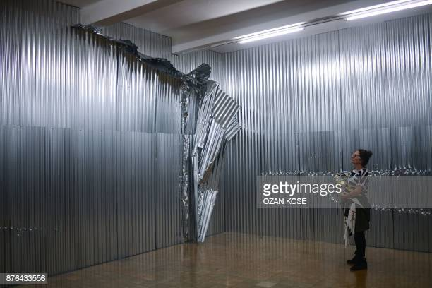 A woman looks at an installation during the 15th Istanbul Biennial on October 20 2017 Almost immediately after the failed coup against Erdogan last...