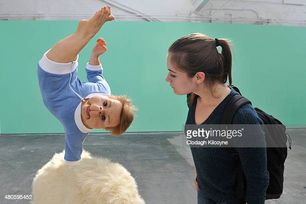 A woman looks at an installation entitled 'The Strength of One Arm by Australian artist Patricia Piccinini on display as part of the Galway...