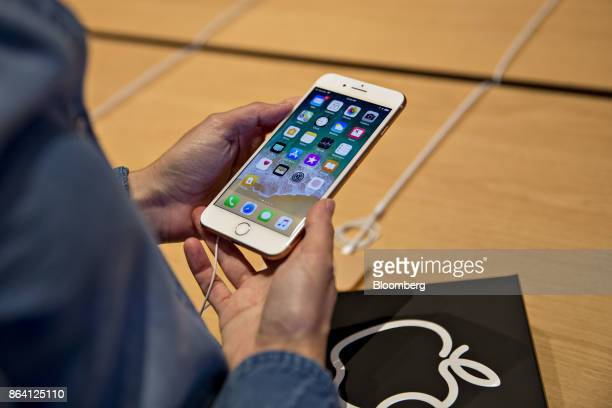 A woman looks at an iPhone 8 Plus on display during the opening of the new Apple Inc Michigan Avenue store in Chicago Illinois US on Friday Oct 20...