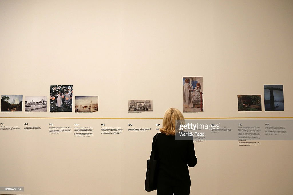 A woman looks at at chronology of artwork on display at the Walk through British Art exhibition at Tate Britain on May 13, 2013 in London, England. Visitors will experience a completely new presentation of the world's greatest collection of British art, the national collection of British art will be displayed in a continuous and purely chronological display from the 1500s to the present day.