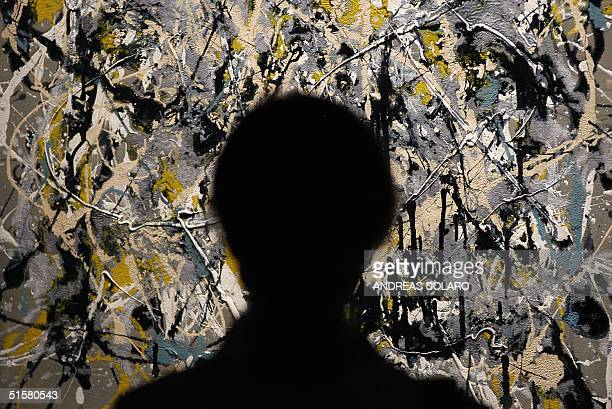A woman looks at 'Autumn Landscape' of famous US painter Jackson Pollock at the museum Palazzo Ruspoli in Rome 27 October 2004 The exhibition called...