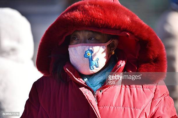 A woman looks at Beijing West Railway Station as she heads back home for the upcoming Spring Festival on February 5 2016 in Beijing China Chinese...
