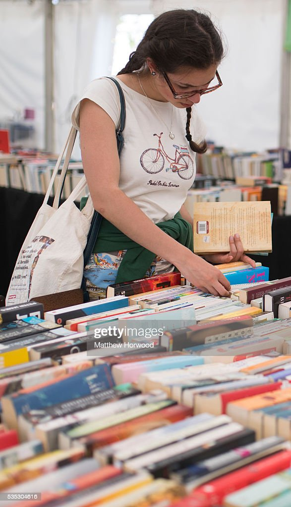 A woman looks at books in a bookshop during the 2016 Hay Festival on May 29, 2016 in Hay-on-Wye, Wales. The Hay Festival is an annual festival of literature and arts now in its 29th year.