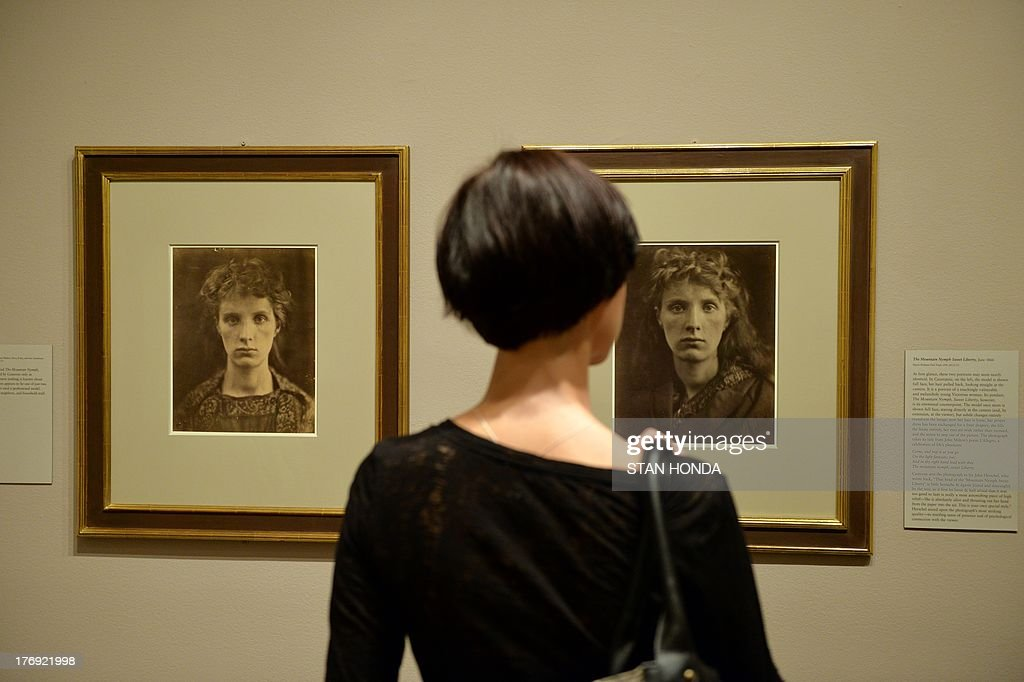 A woman looks at 'Cassiopeia, June 1866' (L) and 'The Mountain Nymph Sweet Liberty, June 1866' (R) photographs of a model identified as 'Mrs. Keene' on display in the exhibition 'Julia Margaret Cameron' featuring work by the great British photographer Julia Margaret Cameron (1815-1879) August 19, 2013 at The Metropolitan Museum of Art in New York. The exhibition is open from August 19, 2013 to January 5, 2014. AFP PHOTO/Stan HONDA