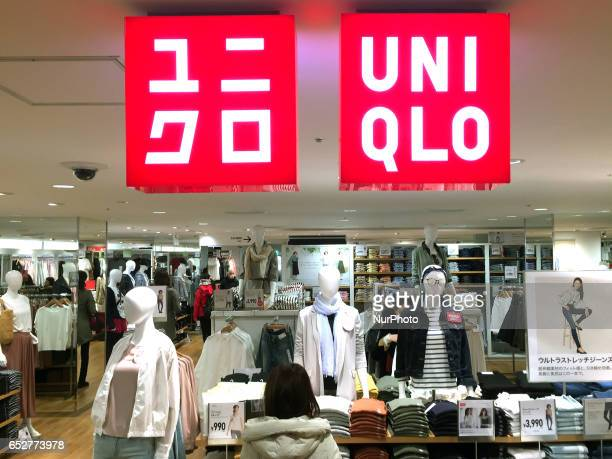 A woman looks at clothes at a Fast Retailing's Uniqlo store in Tokyo Japan March 12 2017