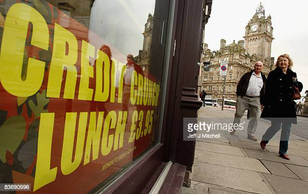 A woman looks at credit crunch lunch sign outside a pub in Edinburgh on November 14 2008 in Edinburgh Scotland With a high likelihood of the Scottish...