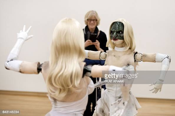 A woman looks at 'Female figure' an animatronic sculpture of a woman by US artist Jordan Wolfson at Stedelijk Museum in Amsterdam on February 20 2017...