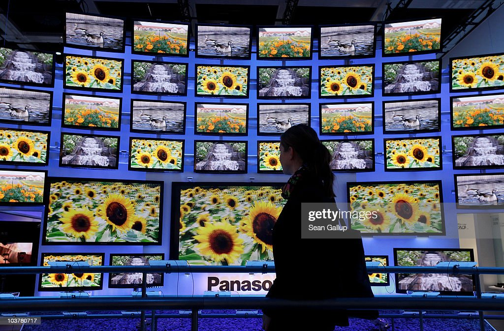 A woman looks at high-definition 3D television screens at Panasonic stand at the 2010 IFA technology and consumer electronics trade fair at Messe Berlin on September 2, 2010 in Berlin, Germany. The 2010 IFA will be open to the public from September 3-8.
