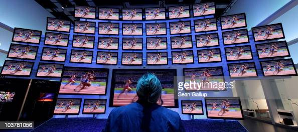 A woman looks at highdefinition 3D television screens at Panasonic stand at the 2010 IFA technology and consumer electronics trade fair at Messe...